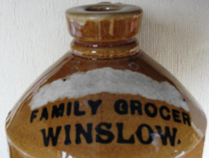 Stoneware flagon marked Family Grocer Winslow
