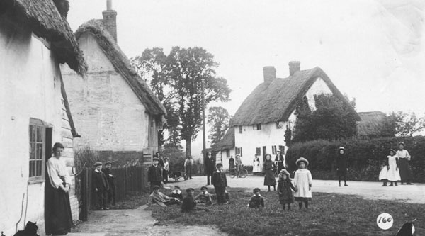 Cottages in Shipton, children playing around the road