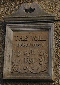 Plaque on renovated wall